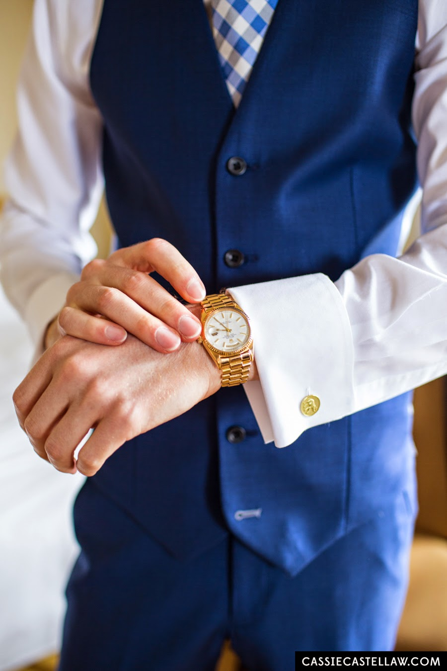 Groom's accessories: Vintage gold Rolex watch and gold elephant cufflinks. NYC Lifestyle wedding photography by Cassie Castellaw. www.cassiecastellaw.com