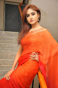 Sony Charista Glamorous in Saffron saree-thumbnail-5