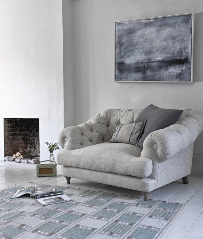 Big White Chair With Moroccan Wedding Blanket And Ethnic Looking Pillows Is  Just Perfect In This All White Living Room.
