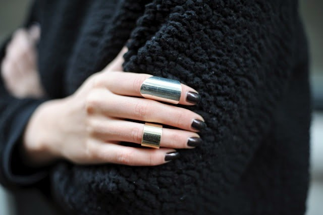 statement jewellery - silver rings and black nails