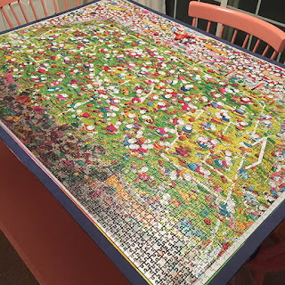 Large puzzle of a soccer game laying on kitchen table