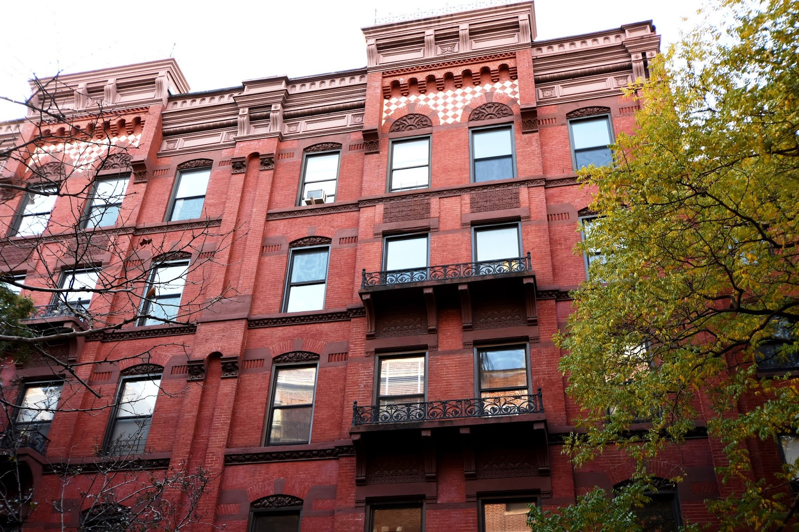 the queen anne styleterra cotta decorations including tiled panels and floral tympanums fanciful cast iron railings on brownstone balconies - Terra Cotta Tile Apartment 2015