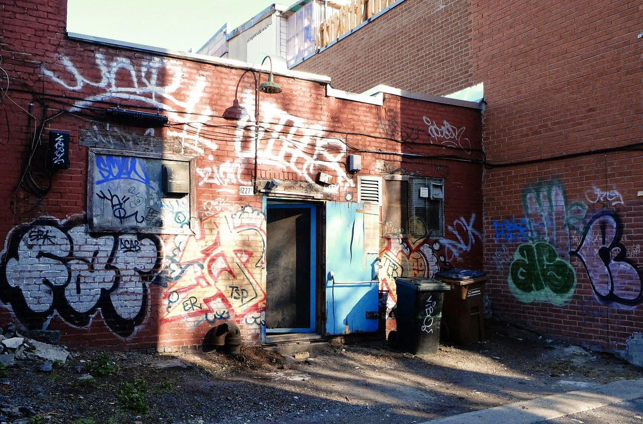Back of Building Covered in Graffiti