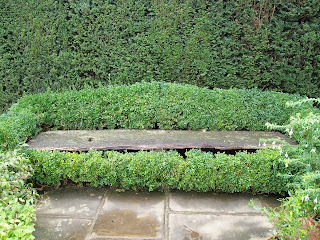 Garden design London and Sussex, bench with box hedge