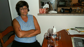 mom deliberating over favourite wine