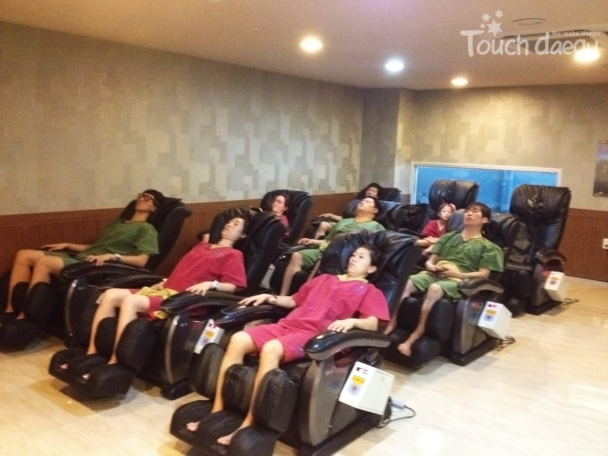 Customers use massage chairs