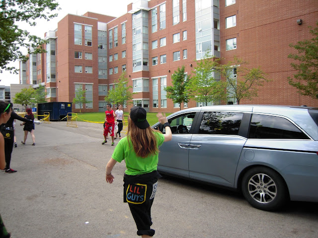 Welcome Week Representatives help direct a van into a spot to unload it during residence move in.