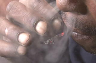 Smokers fingers and lips are burned and blister due to addits not want to throw away any butts of their Nyaope