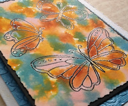 Technique with Tim Holtz daubers...