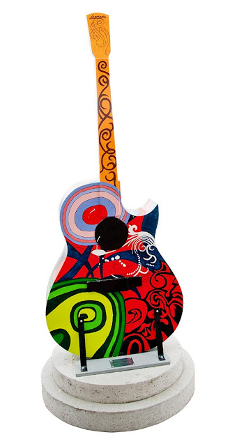 Orillia painted guitar display, multicolour abstract design with red and black