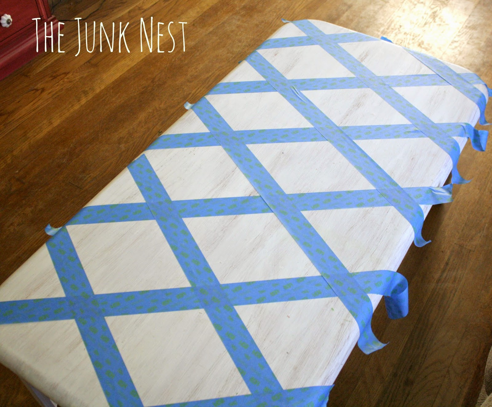 The junk nest diy painted coffee table i taped off a diamond pattern with painters tape and then i sanded all the diamond shapes this whole project literally took me about 20 minutes geotapseo Images