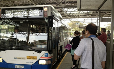 A half-hourly Sydney bus departs too full to take on passengers at the Edgecliff rail interchange