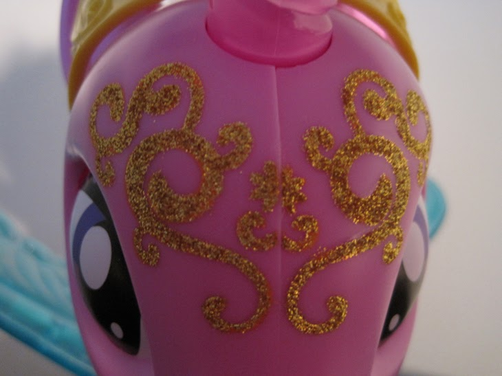 MLP: FiM Talking Princess Twilight Sparkle, close up of glitter design on forehead.