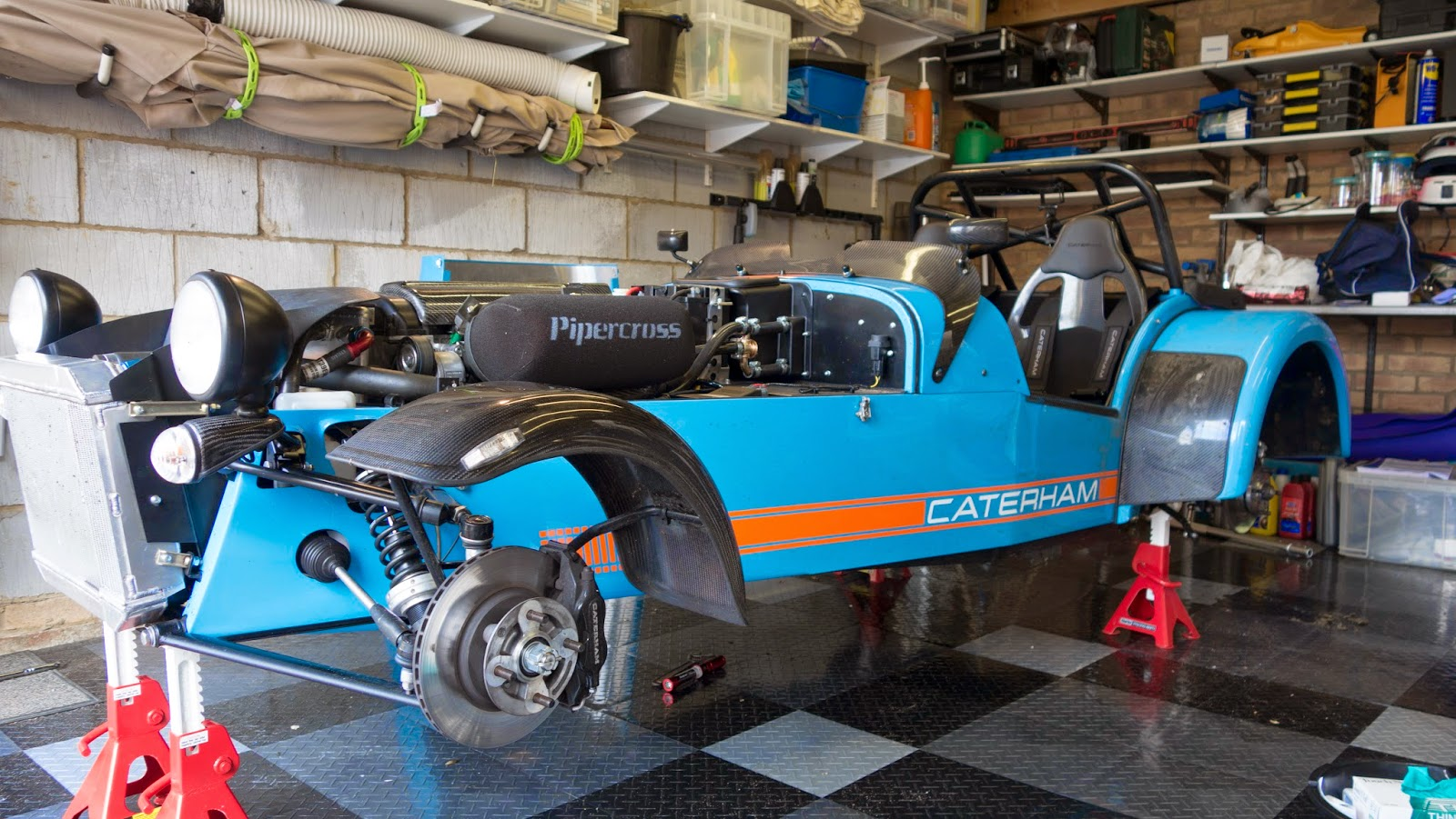 Caterham R500 after wales blat with wheels off ready for cleaning and spanner check.
