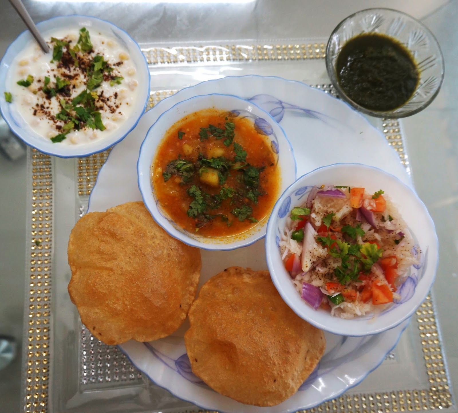Aloo Poori with Raita, mint chutney and salad
