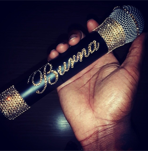 Burna Boy with Gold plated microphone