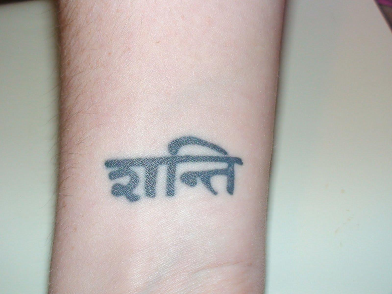 To love a rose tattoomoval shanti sanskrit for peace just above my right wrist i might laser this and have something put in its place buycottarizona