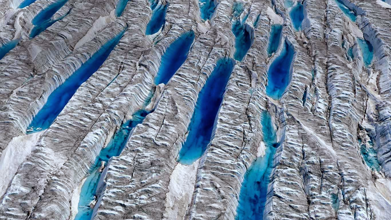 Meltwater on the Greenland ice sheet, Greenland (© James Balog/Aurora Photos) 18