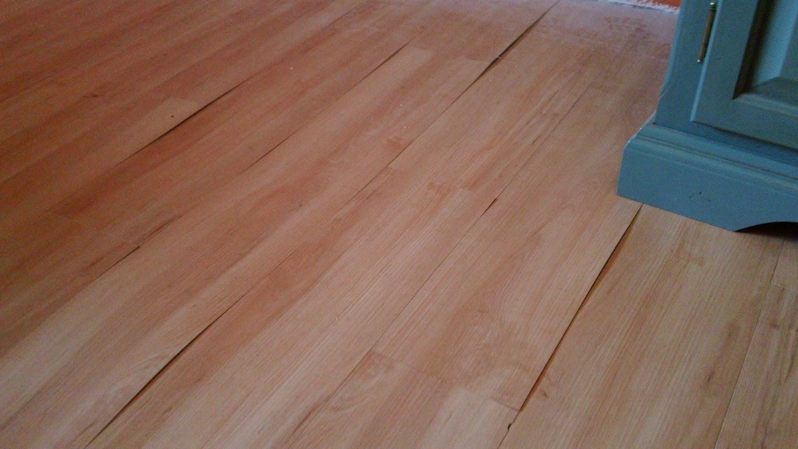 Laminate flooring water leak under laminate flooring for Laminate flooring to carpet