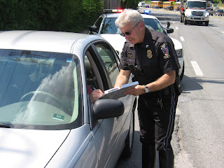 Montgomery County Police ticketing a driver who did not yield to a pedestrian