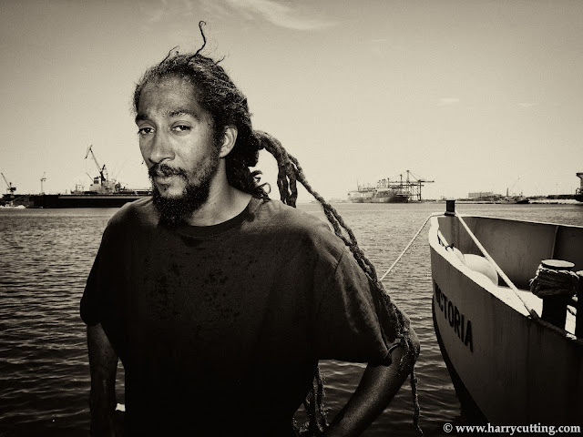 Rasta boat captain Daniel Murray poses in Freeport Harbour, Grand Bahama.