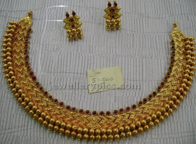 tussi set in gold from varakrupa jewellers