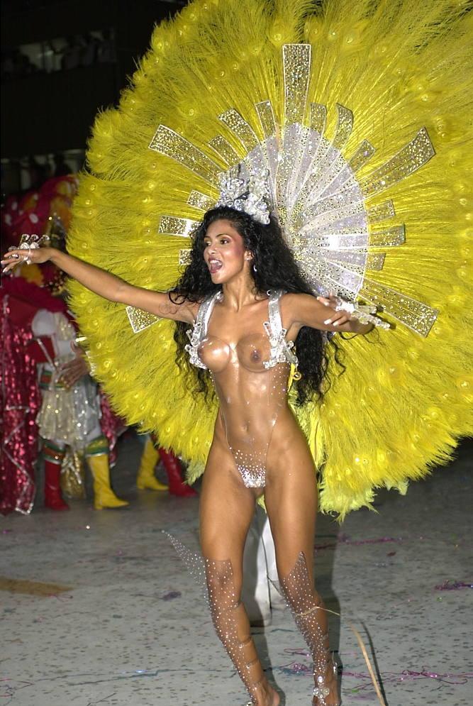 The prettiest girl in Carnival. She's wearing a plexiglas outfit. After parading a few years at Unidos da Tijuca Samba-School, Fábia Borges was invited to become the Carnival Drum Queen for the Academics da Rocinha Samba-school, where she has supported since 2006.