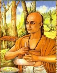 chanakya holding stick