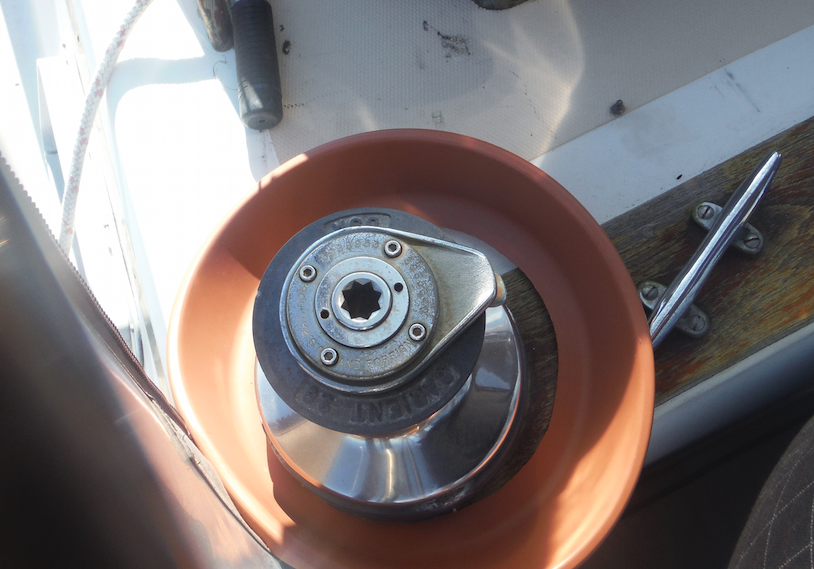 Barient Winch with small put bottom around it to prevent items from falling overboard