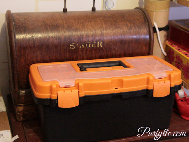 Ugly toolbox ruining the prettiness of the vintage singer