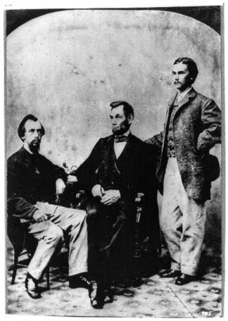 Lincoln sits with his private secretaries