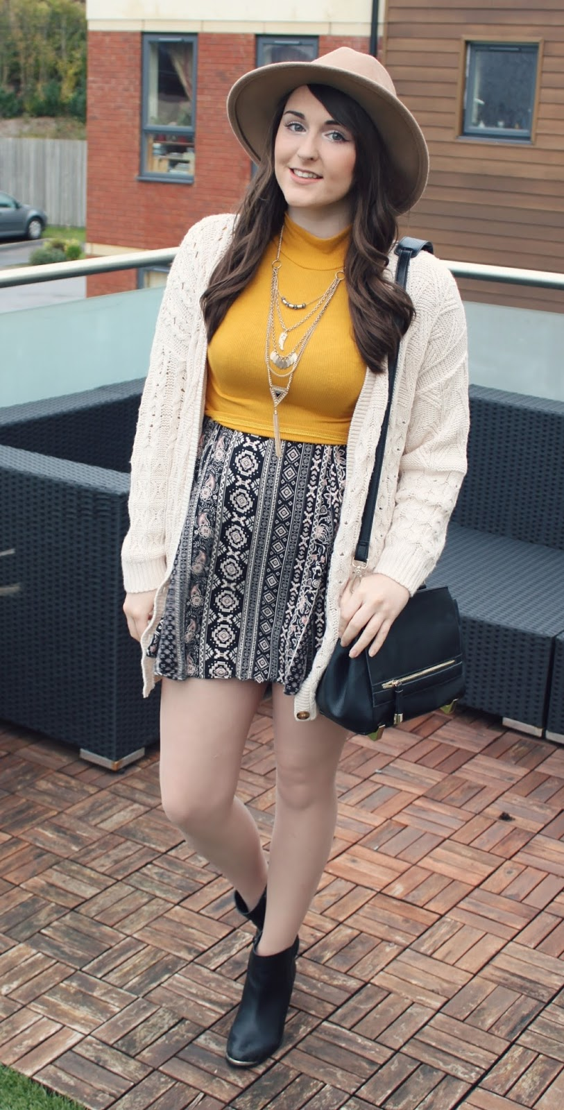 bohemian-layered-outfit-mustard-crop-on-aztec-dress