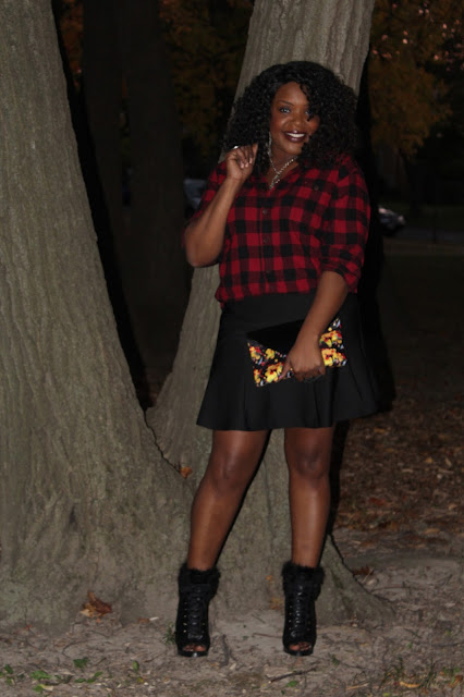 A-fall-fashion-staple-the-ever-popular-red-and-black-flannel-styled-with-girly-basics-like-a-black-flirty-skirt-vintage-silver-chain-necklace-and-fur-trimmed-open-toe-booties-