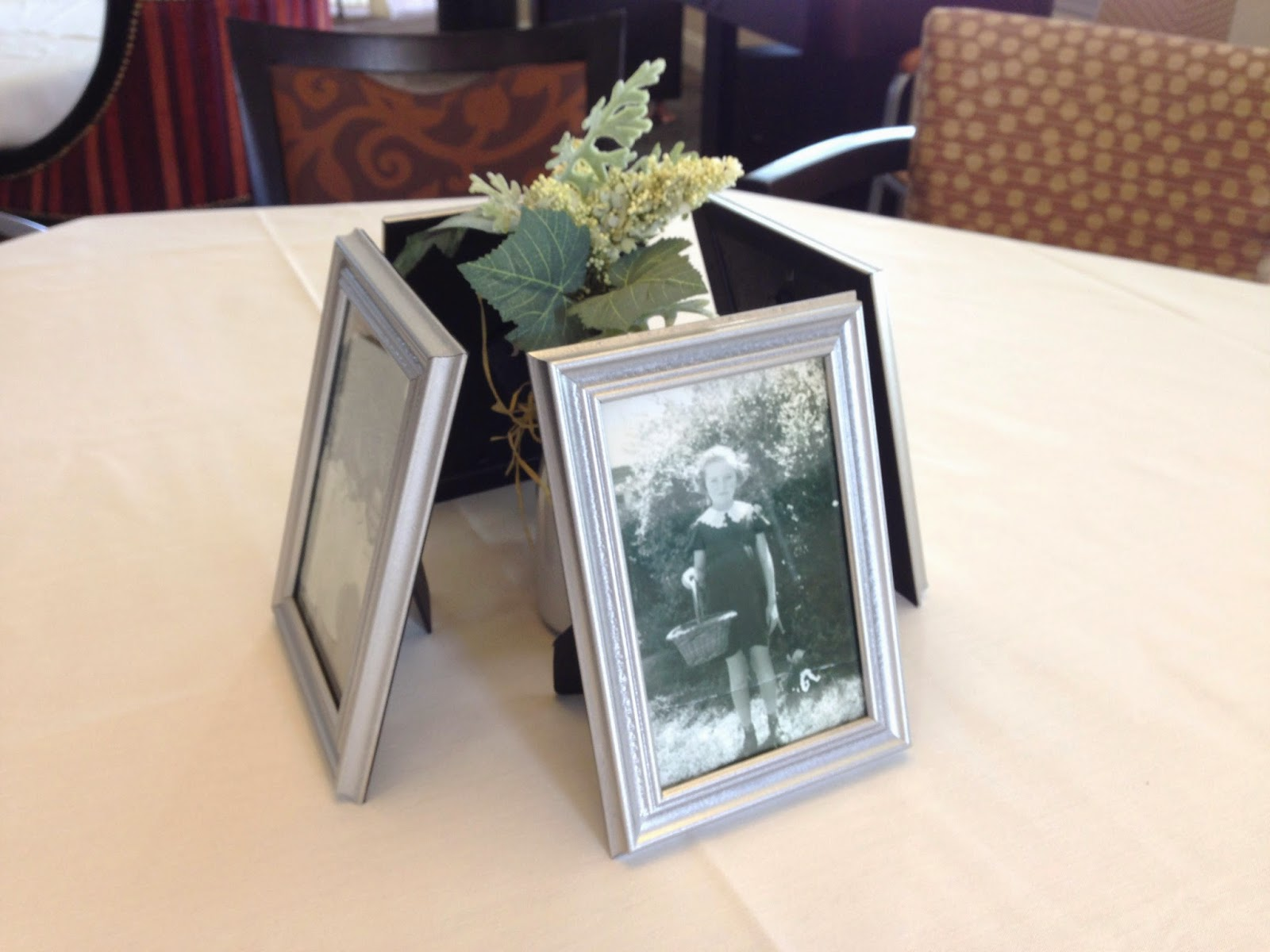 For The Centerpieces I Used Little Vases Filled With Greenery And Placed Four Pictures Of My Mom At Different Stages Throughout Her Life Around