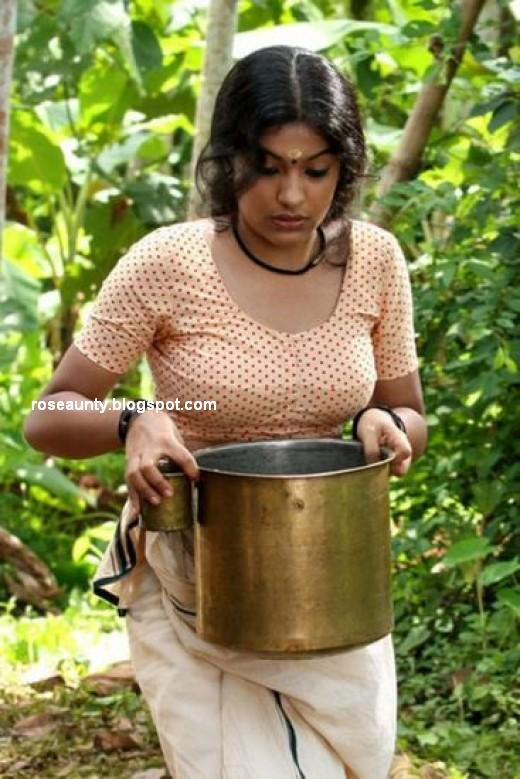 south indian actress wearing mundu and blouse