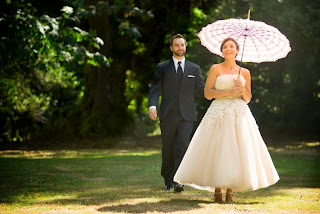 Travis & Victoria with her parasol - Ceremony officiated by Kent Buttars, Seattle Wedding Officiant