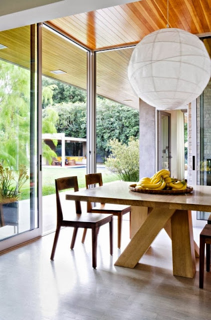 floor to ceiling glass windows and rolling doors gives a view to the pool while making this a great spot for a quick breakfast