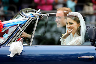 The happy couple looks picture perfect as they ride in a car after being married.