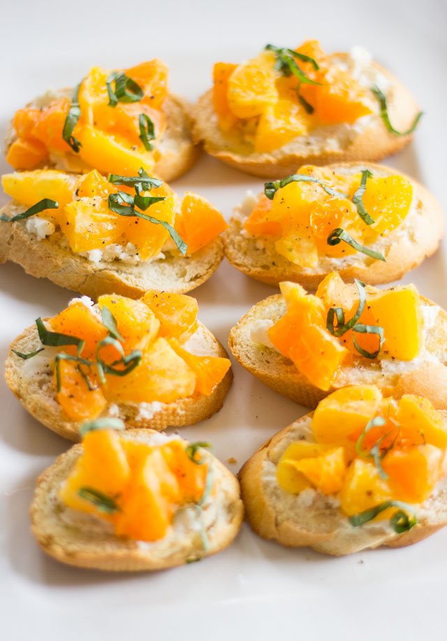 Clementine goat cheese crostini - the touch of black pepper and basil makes them SO good!!