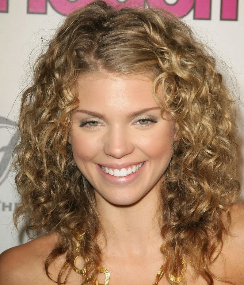 Medium Length Curly Haircuts A shoulder length hairstyle with curly