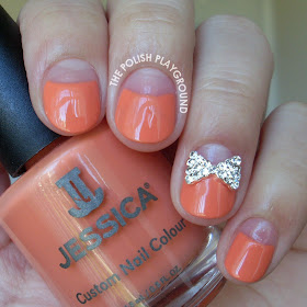 Orange Negative Space Half Moon Manicure with Bow Stud Nail Art