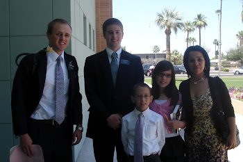 Elders Faldmo and Kinney with a family