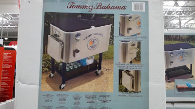 Tommy Bahama Roller Cooler with side table, storage space, and bottle opener