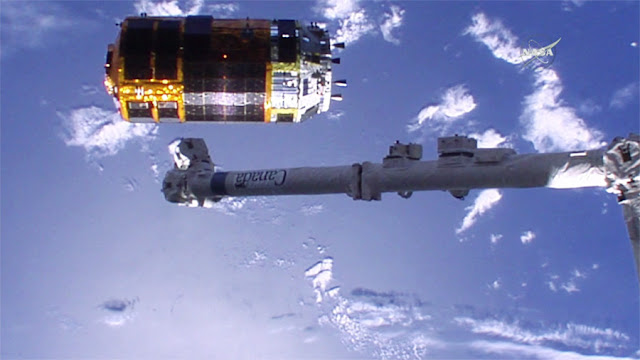 "The Canadarm2 robotic arm backs away from the just released ""Kounotori"" HTV-5 resupply ship. Credit: NASA TV"