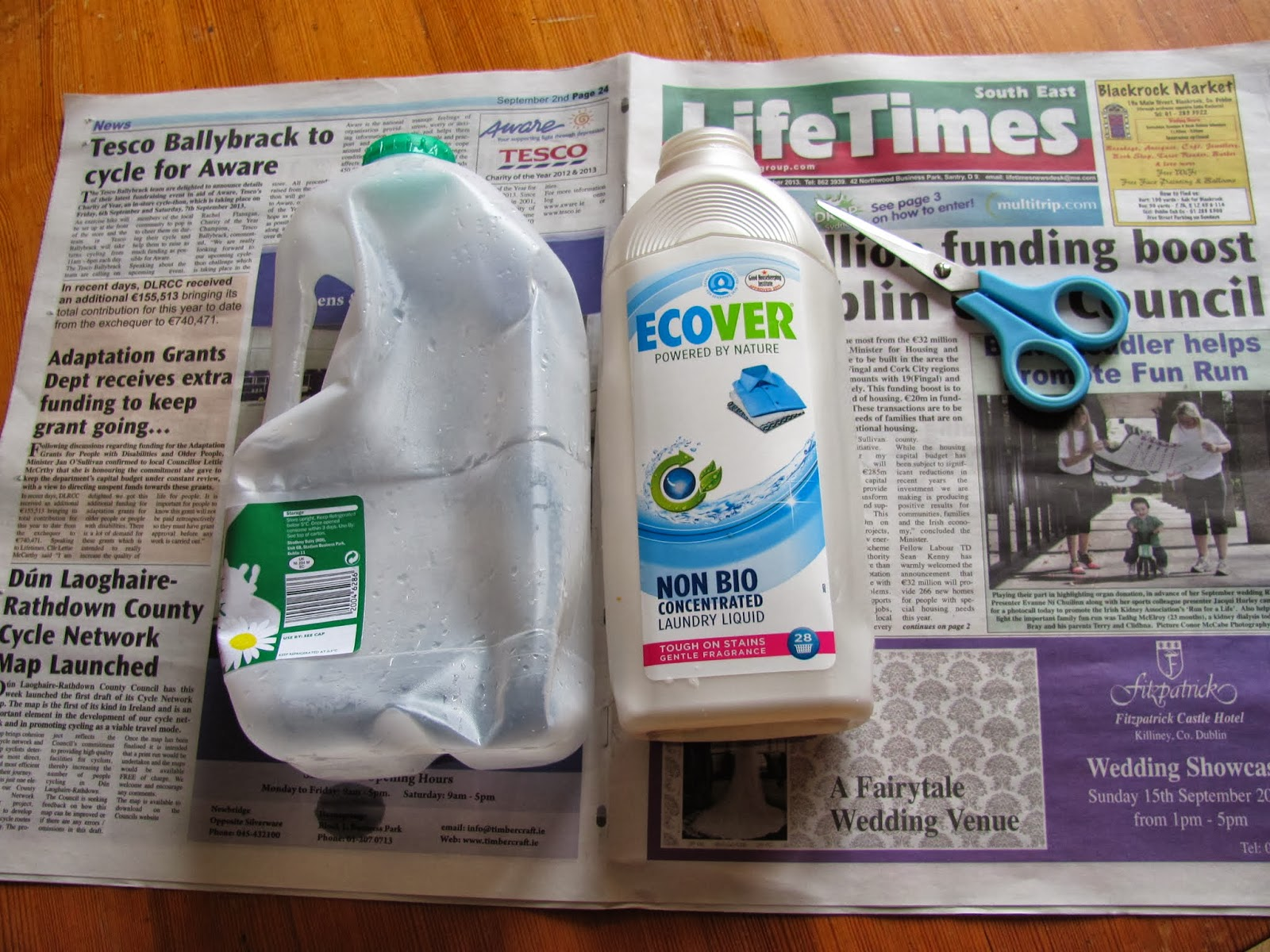 A milk jug and a laundry soap jug ready to be cut into bicycle fenders