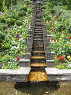 Stair-step waterfall bordered by flowers, Mainau, Germany