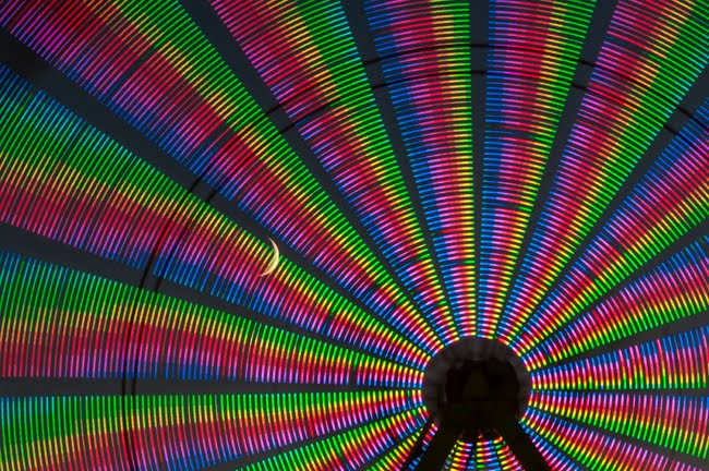 Ferris Wheel in Motion with Crescent Moon