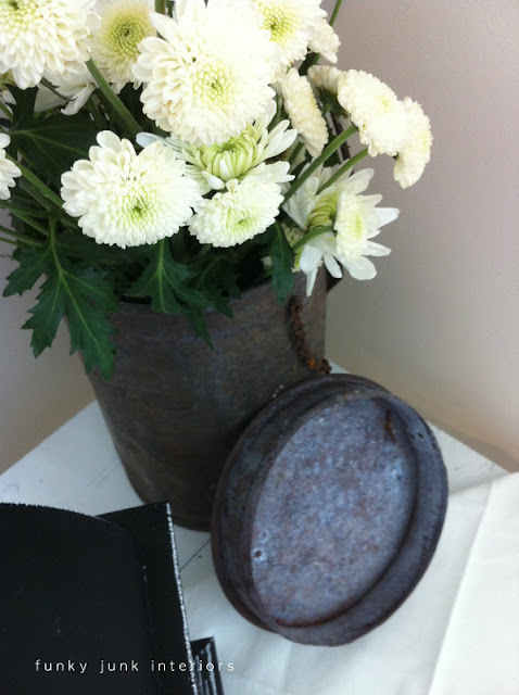 rusty metal junk flower vase