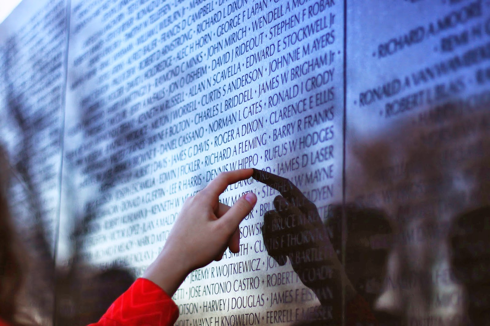 Finding a name on the Vietnam Memorial