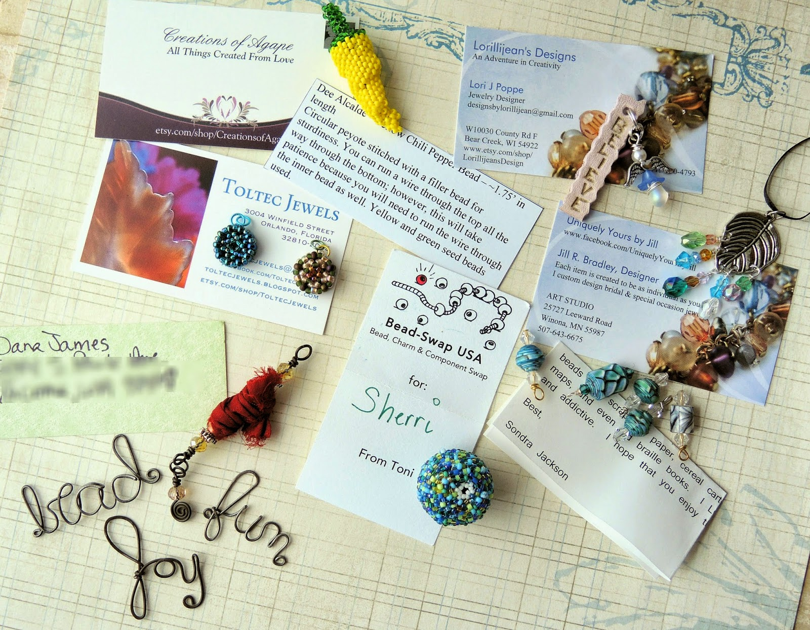 Artists' charms made of bead weaving and other mediums.